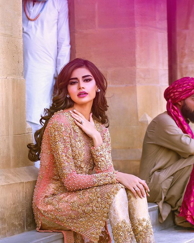 We love how stunning #SadafKawal looks in this coral and gold embellished outfit from our s/s '16 collection! Now available at #MinaHasan stores in Lahore and Karachi - please call us at 021-35301929 or 042-35753223 or email us at minahasan@gmail.com for queries and online orders.