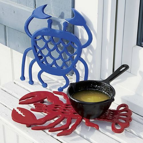 Nautical Trivets: http://www.completely-coastal.com/2016/05/coastal-nautical-kitchen-gadgets.html Blue crab, fish, and red lobster trivets!