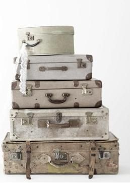 stack of white vintage suitcases...