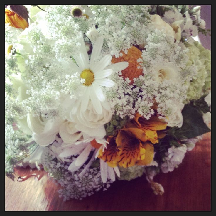 Bridesmaids bouquet with Queen Anne's Lace, chamomile, alstroemeria, roses, ranunculus, viburnum snowball, hydrangea, Sweet William, poppies and billy button.