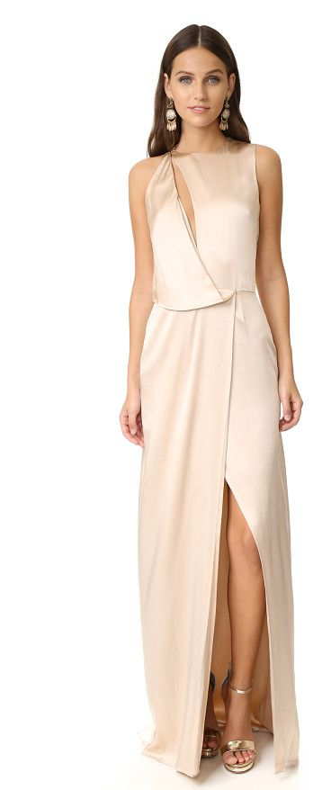 Draped cutout gown by Halston Heritage. Angled draping brings fluid elegance to this lustrous silk Halston Heritage gown. Crisscross straps detail the cutout...