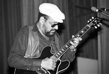 """MacHouston Baker (October 15, 1925 – November 27, 2012), known as Mickey Baker and Mickey """"Guitar"""" Baker was an American guitarist. He is widely held to be a critical force in the bridging of rhythm and blues and rock and roll, along with Bo Diddley, Ike Turner, and Chuck Berry."""