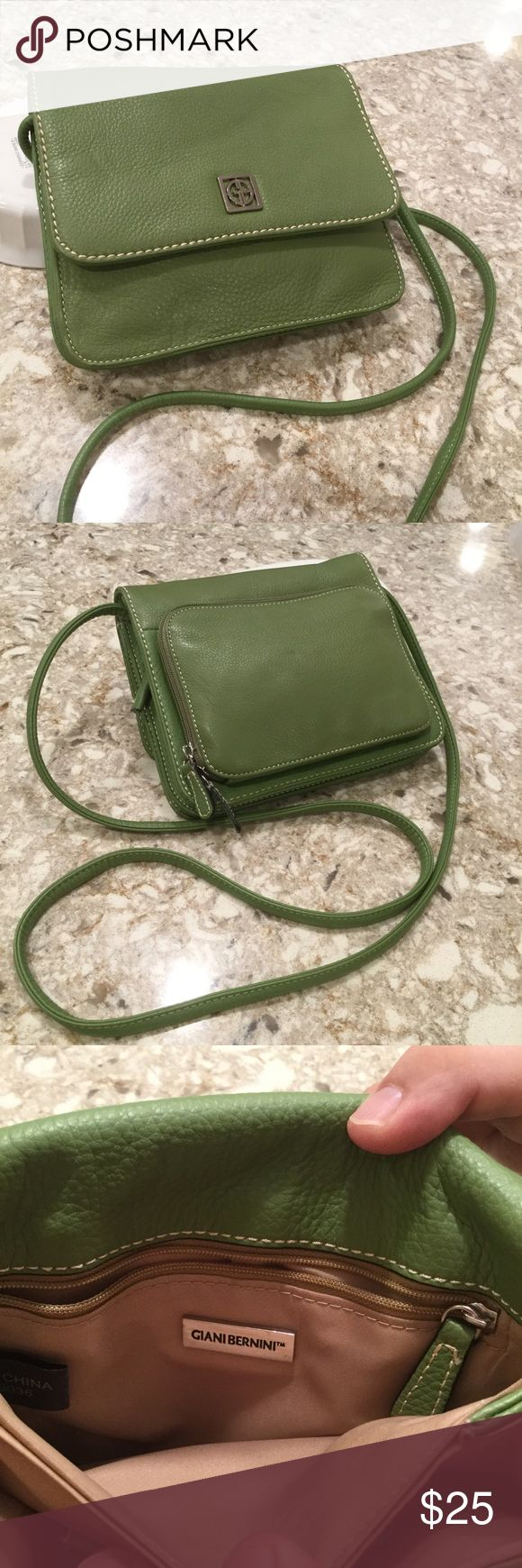 """Gianbernini green pebble leather cross body Excellent condition. No wear and tear.  GREEN. Exterior:  outside zip pocket 4 credit card slits, cell phone pocket, open pocket with key chain. Also, under flap, zip pocket, interior:  3 pockets with back zip pocket, 2nd cell phone pocket. Plenty room for iPhone six plus, 25"""" strap, 8 1/4 x 7 x 3 Gianbernini Bags Crossbody Bags"""