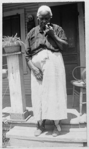 """JULIA FRANCIS DANIELS, born a slave, 1848, in Georgia. """"I has 17 chill'en through the year. I ain't what I used to be for work'in. I done plenty work in my primer days."""" (Texas Slave Narratives 1936-1938)"""