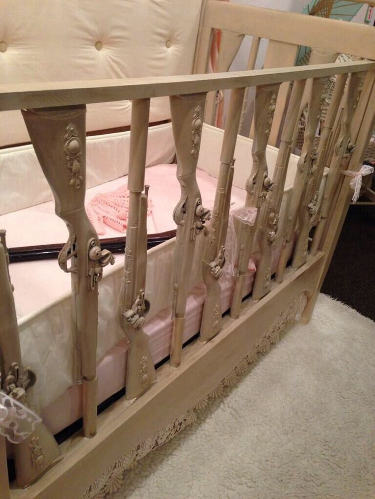 Hand carved shotgun baby crib. OMG.