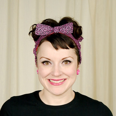 Pink Leopard Hair Danna:This is the perfect alternative to wearing a plain old bandana in your hair. This is a cotton headband with four rows of elastic around the back along with a ruffle to hold it in place whether you have short hair or long hair. The front is lined in red and topped with a bow (so it's perfect if you're... $14.00