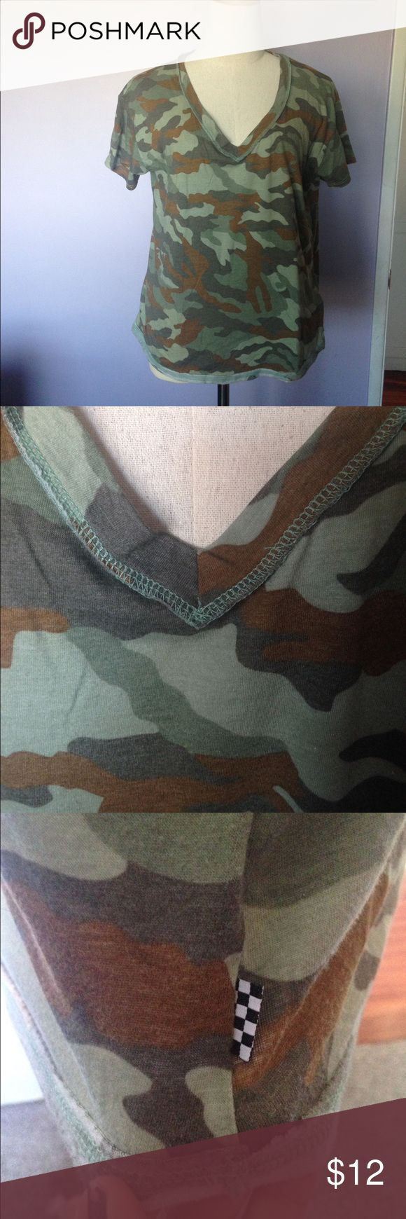 Vans camo printed short sleeve T-shirt Vans camo printed all over short sleeve V-neck T-shirt. Top of V-neck and bottom hem shows reverse stitching where stitching is intended to be seen on the outside. Size XL. Very thin material, a bit see-through. Vans Tops Tees - Short Sleeve