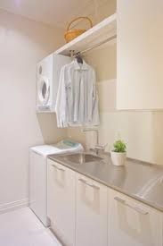 Image result for laundry cupboards top loader