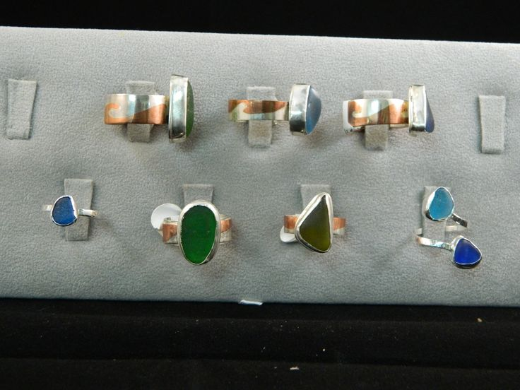 Seaglass rings set in .925 silver bezels. Band is made from copper & .925 silver and is called marriage of metal. Sizes range from 6-9. $65
