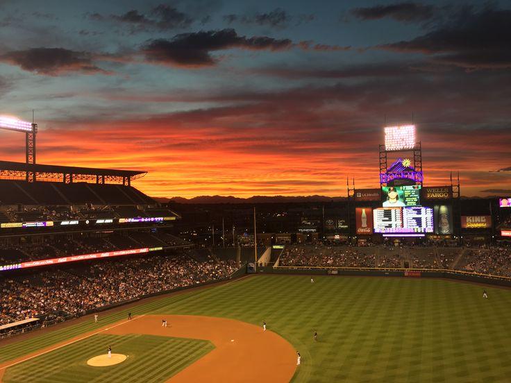 Vibrant sunset over a Rockies vs. Giants game. Denver, CO.