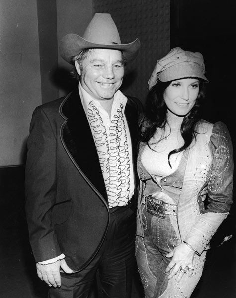 Loretta and husband Oliver Lynn walk the red carpet at the Country & Western Music Awards in Hollywood, Calif., on  Feb. 27, 1975.  Photo Credit: Hulton Archive/Getty Images
