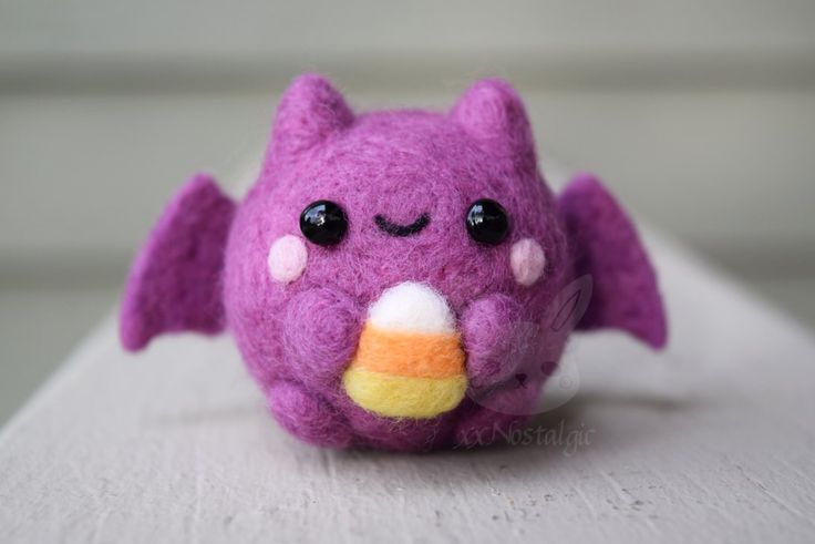 http://www.deviantart.com/art/AUCTION-AND-GIVEAWAY-Felted-Candy-Corn-Bat-563841071