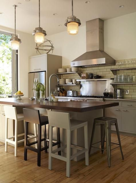 Love the neutrals used in this kitchen. And the fact that all three bar stools are a different colour.