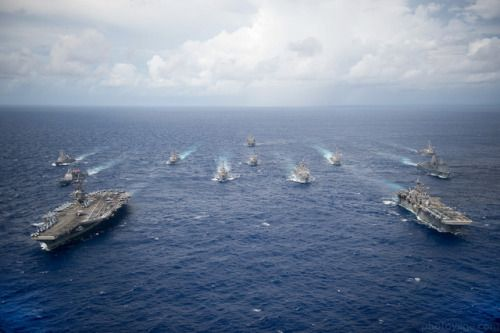 PHILIPPINE SEA (Sept. 23 2016) USS Ronald Reagan (CVN 76) and USS Bonhomme Richard (LHD 6) lead a formation of Carrier Strike Group Five and Expeditionary Strike Group Seven ships including USS Momsen (DDG 92) USS Chancellorsville (CG 62) USS Stethem (DDG 63) USS Benfold (DDG 65) USS Curtis Wilbur (DDG 54) USS Germantown (LSD 42) USS Barry (DDG 52) USS Green Bay (LPD 20) USS McCampbell (DDG 85) as wells as USNS Walter S. Diehl (T-AO 193) during a photo exercise to signify the completion of…