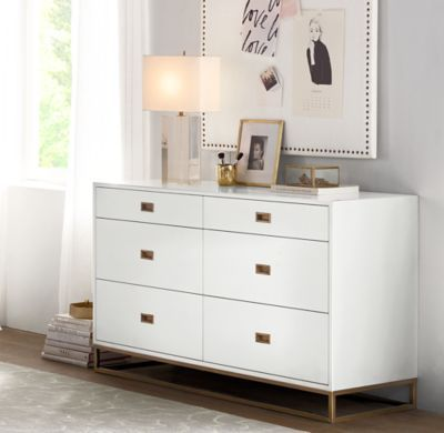 RH TEEN's Avalon Wide Dresser:The sleek lines of our collection capture the sophisticated restraint of modernism, while its polished cast-metal fittings – including recessed pulls and a metal base – take it in a new direction.