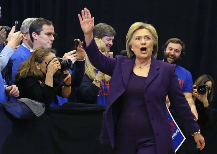 Clinton takes Iowa, beating back Sanders' strong challenge  -     Democratic presidential candidate Hillary Clinton waves as she arrives at a campaign event, Tuesday, Feb. 2, 2016, in Nashua, N.H.
