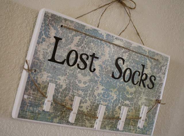 """I love this. """"Lost socks"""" sign that has clothes pins to hold up the socks. Hang it in the laundry room and it makes pairing those socks easy!"""