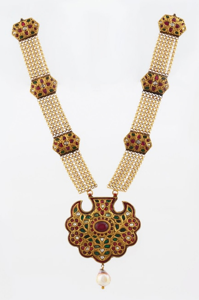 ****AN IMPORTANT RUBY AND EMERALD NECKLACE          Set with approximately 18.28 carats of rubies and emeralds, and approximately 3.64 carats of table-cut or 'polki' diamond, this necklace mounted in gold has an intricately designed chain attached with hexagonal gem-set links. The reverse bears an intricate design in polychrome enamel.
