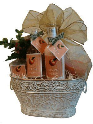 """Deluxe Georgia Peach Bath Basket by Georgia Gifts. $59.95. Treat yourself or someone you love to a relaxing spa--Southern style! Elegantly presented in an embellished ivory tin, our finest peach-scented bath products will delight her senses. This Georgia gift includes 8 oz. Body Wash, 8 oz. Lotion, Scented Candle, Peach Scented Crystal Potpourri (4 oz.), Peach Tea, and net sponge. Perfect as a Christmas gift, corporate gift, thank you gift or thinking of you! Measures 10"""" x..."""