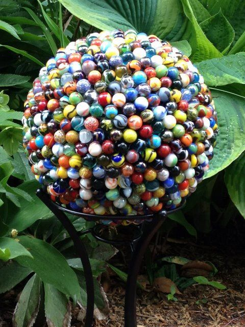 Garden globe made from a bowling ball and marbles!  #gardenart homechanneltv.com