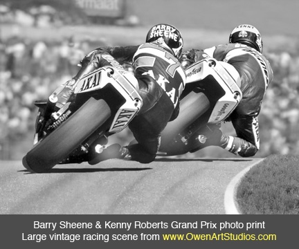 500 GP action. Barry Sheene follows King Kenny Roberts. You can just see buffs of smoke from both exhausts.