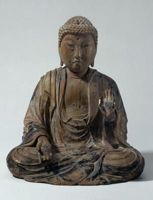 Seated figure of the Buddha Amida. Japan. Kamakura period (AD 1185-1333). Wood, glass or crystal, traces of lacquer. h 20.6 cm. Acquired 1967. Robert and Lisa Sainsbury Collection. UEA 281