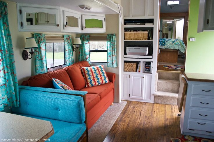 RV/Trailer Makeover: Love the splashes of color against the white.  They marry the areas and differences also define them.  Don't know that I love the mix but it's a great way of defining a small space.