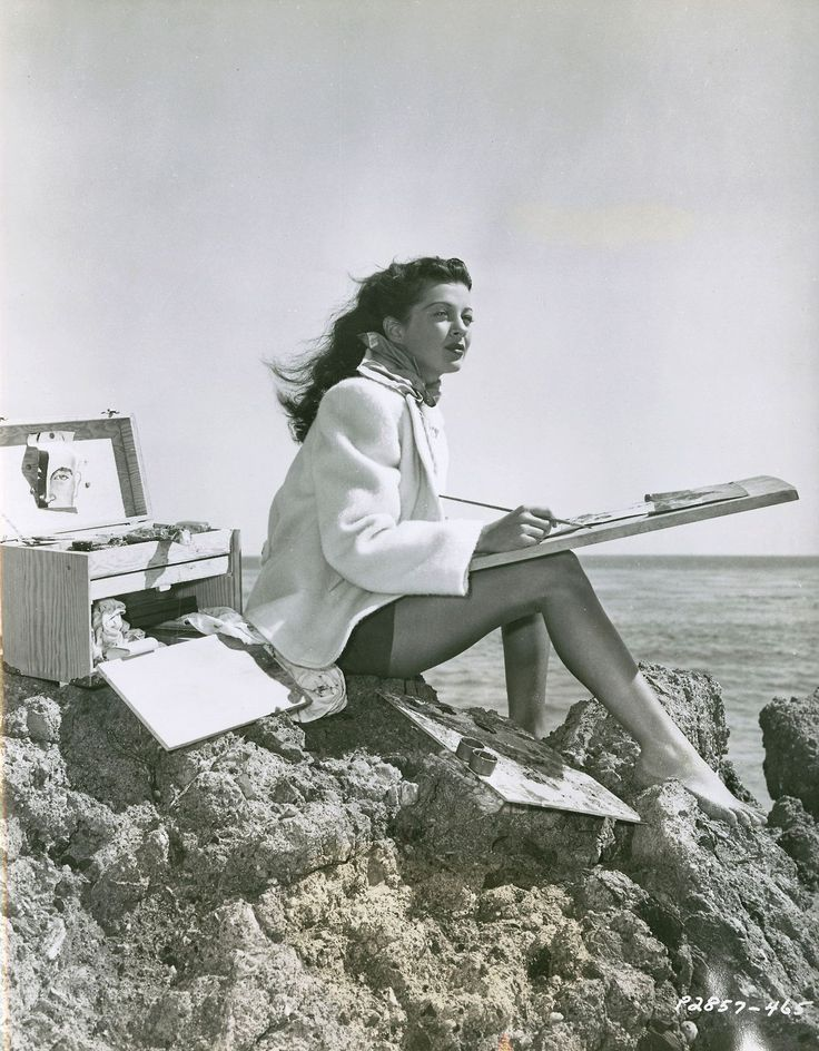 Actress Gail Russell painting. For the last eight months of her life, Russell sealed herself up in her home at 1436 Bentley Ave., and sketched and painted and drank until the place was full of art and empty liquor bottles. Her sister-in-law phoned every day in the week before she died (at age 36). Russell told her she was painting and sketching and planning to get back into acting.