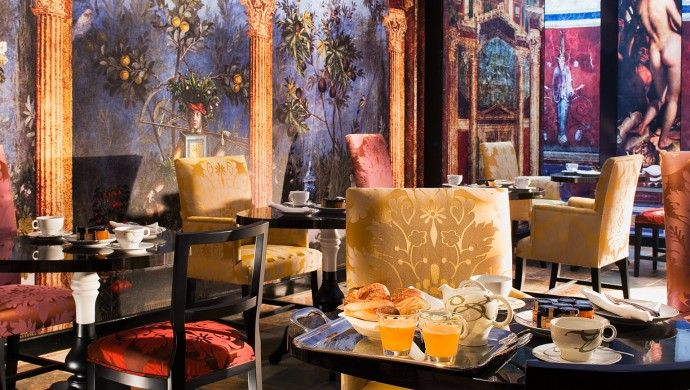 Le Bellechasse Saint-Germain, Paris.  With its muraled walls, the breakfast room pays homage to more classical works of art.