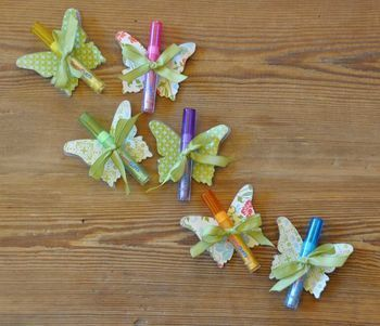 Lip Gloss Butterflies - she used plastic milk carton on the back for stability - could use acetate punch two holes to run ribbon thru.