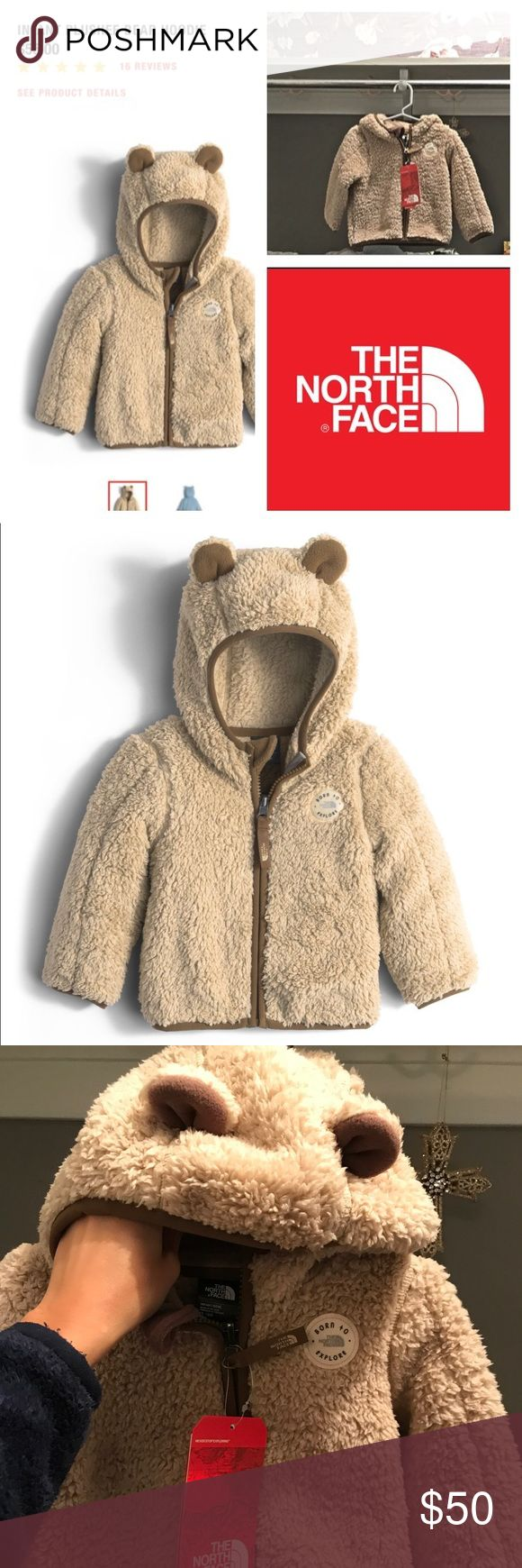 """North Face Infant Plushee Bear Hoodie Keep your wild child warmer with this soft fleece hoodie that's crafted with cozy hood finished with two bear ears.  Features :  •Warm, soft fleece hoodie with bear ears •Elastic binding on cuffs and hood •Novelty bear ears on lofty fleece side •Patch logo on front  Product Specifications:  STYLE: NF0A2TMV AVG WEIGHT: 210 g (7.4 oz) CENTER BACK: 12.25"""" FABRIC: 330 g/m² 100% polyester plushee fleece SOURCE: Imported GUARANTEE: Lifetime Warranty CARE…"""