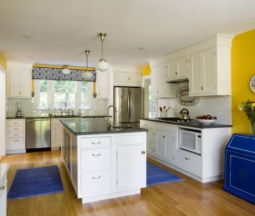 Brilliant sunflower yellow walls various blue accents for Blue kitchen cabinets with yellow walls