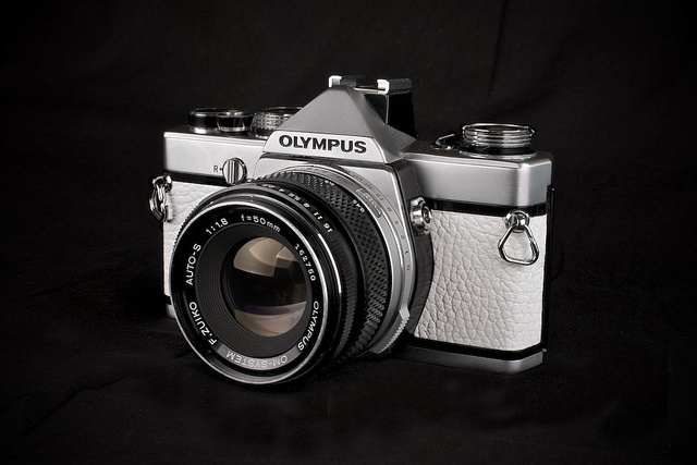 AFTER....... Olympus OM-1 a la carte    Ok, well here she is, not what I'd normally do with my cameras but as I had two of them it seemed reasonable. Yes, its probably completely impractical, but I'm pleased with how it looks........by J Howe, via Flickr