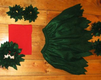 Handmade costume inspired by Disneys Lilo and Stitch. Lilo costume is available in size newborn through childrens size 8. It features the layered green leaf hula skirt. Red bandeau top. Green leaf halo. Green leaf arm and ankle bands. Costume can be ordered as a complete set or just skirt and top. ***The costume DOES NOT include Stitch plush that is pictured. It is just a photo prop.***** Check out our handmade Stitch costume here…