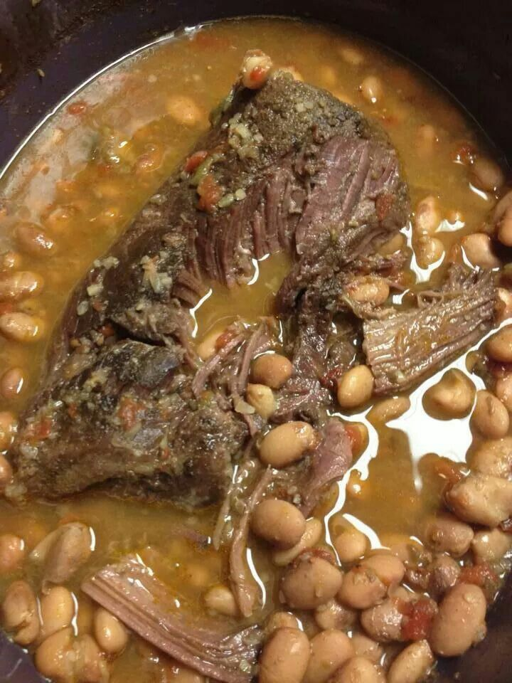 CROCKPOT ROAST & PINTO BEANS: - In a crockpot put 2 cups of raw pinto beans on bottom, mix in can rotel & some green chili. - season beans with cumin, garlic powder, a little chili powder & minced onion. - place roast on top & season same way. - add water to cover beans & about 1/2 of roast (may need to add water as cooking). -turn crockpot to high & cook until roast falls apart & beans are done. - I then switch to low so spices can simmer. -