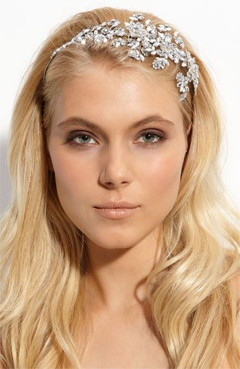 Tasha 'Crystal Garland' Headband  Twining crystal flowers sparkle atop a slender metal headband.   Metal/crystals.  By Tasha; imported.  $98.00