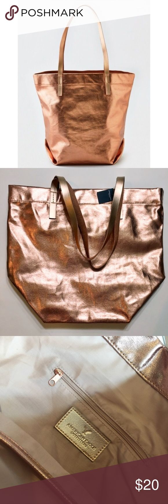 """AEO Metallic Shiny Canvas Tote Rose Gold NWT NWT Rose Gold Metallic Canvas Tote from American Eagle Outfitters. Shoulder straps, 2 interior open pockets for cell phone and other goodies and 1 interior zip pocket. 100% cotton with shiny exterior. Perfect for school, overnight bag or just an everyday on the go tote. Dimensions are 15"""" x 18"""" x 7.5"""". American Eagle Outfitters Bags Totes"""