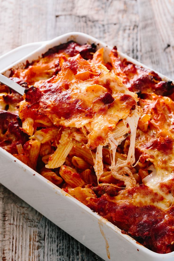 Italian Sausage and Peppers Baked Ziti Recipe. Meal planning for that upcoming trip where you'll be spending some time cooking on vacation? Add this to your list of ideas. This comforting, simple, budget dinner recipe is a real crowd pleaser that everyone will love. Makes a huge batch too, leaving plenty of leftovers for snacking the next day.