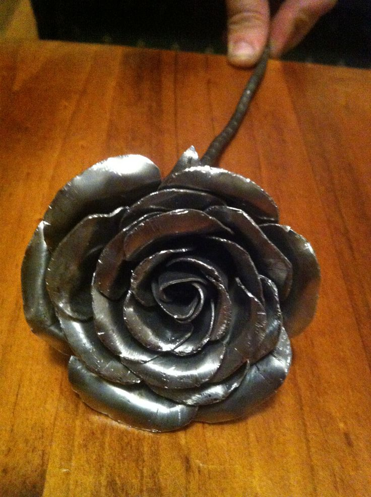 Perfect as a gift, decorations around home or at weddings and functions. These roses are all handmade using recycled steel so no two are identical. Forged of 1mm steel, they have a nice, solid weight to them and don't feel cheap or tacky at all.  Can be painted on request and made to almost any size.  Can also be seen on Instagram by searching the user @RustedFabrications.