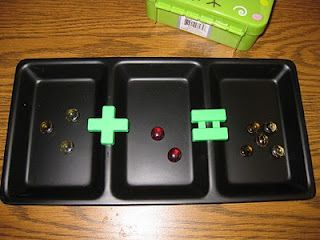 Tray with three sections used for addition with manipulatives