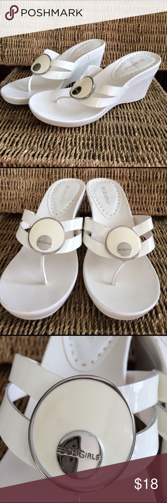 """BCBGirls white wedge flip flops Just in time for the warmer weather!  White thong sandals with a 3"""" wedge.  White circle with silver outline and BCBGirls logo on front.  Leather upper.  Size 8 BCBGirls Shoes Wedges"""