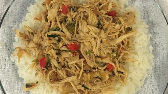 Pollo mechado, a Venezuelan dish of shredded chicken with onions and bell pepper, is easy to prepare. Serve with arepas for a meal.
