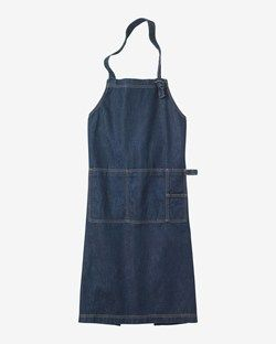 Apron in very good quality indigo denim with contast stitching. Two wide straps cross over at back. Two patch pockets.
