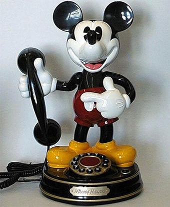 Mickey Mouse phone  Ours is black and white and sits in the office :)