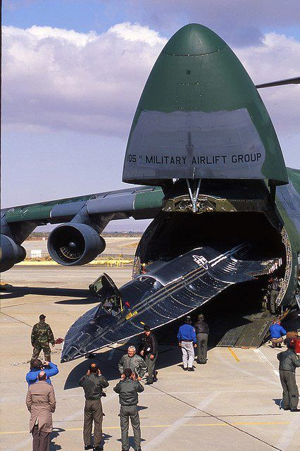 SR-71 emerges from a C-5 Galaxy heavy lift aircraft HOLY ROCKETSHIPS Batman, what else can that thing swallow ?