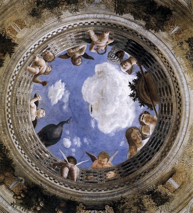 Palazzo Ducale Mantova - Camera degli Sposi    La decorazione della stanza venne commissionata da Ludovico Gonzaga a Mantegna, pittore di corte dal 1460. La sala aveva originariamente una duplice funzione: quella di sala delle udienze (dove il marchese trattava affari pubblici) e quella di camera da letto di rappresentanza, dove Ludovico si riuniva coi familiari.