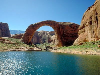 """Rainbow Bridge in Utah is the world's largest known natural bridge, spanning about 275 feet and reaching about 290 feet tall at the top of the arch. The monument has long been sacred to Native Americans, who originally named it """"Nonnezoshe,"""" meaning """"rainbow turned to stone."""" Image Credit: iStockphoto/Thinkstock"""