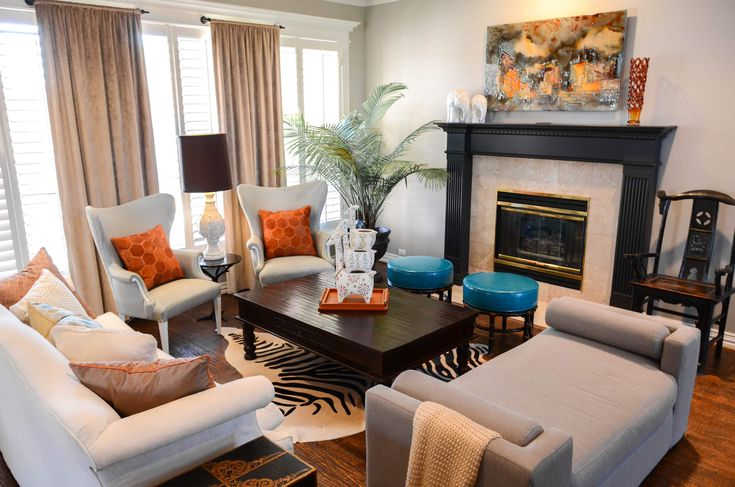 Fireplace Makeover To Change Fireplace In Your Home Design: Zebra Rug With Dark Wood Flooring And Dark Wood Coffee Table Also White Sofa Plus Art Above Fireplace And Black Fireplace Mantel To Fireplace Makeover For Eclectic Living Room Design