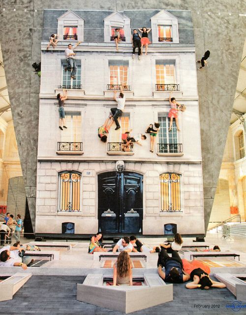 argentinian artist Leandro Erlich---building facade built on the floor placed in front of a gigantic mirror, creating an optical illusion! engages visitors who playfully interact with the installation!!! super cool!