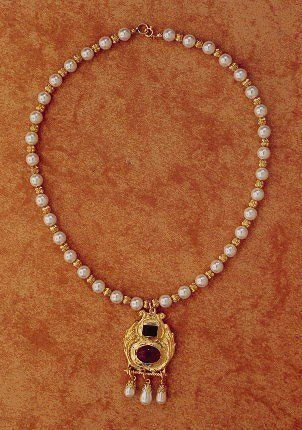 The Princess Elizabeth necklace and pendant, based on the portrait of young Princess Elizabeth,   attributed to the circle of William Stotts and hanging in Windsor Palace.